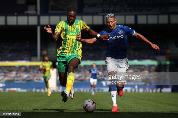 TOPSHOT West Bromwich Albion's Nigerian defender Semi Ajayi vies with Everton's Brazilian striker Richarlison during the English Premier League...