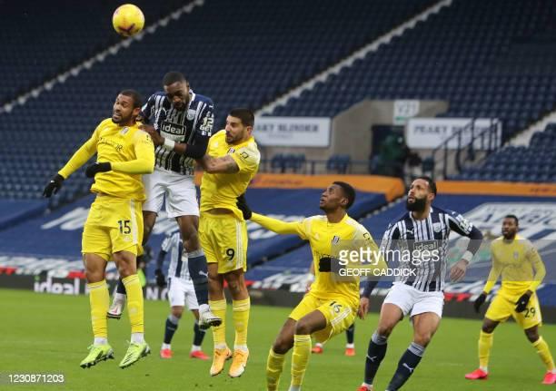 West Bromwich Albion's Nigerian defender Semi Ajayi vies with Fulham's English midfielder Ruben Loftus-Cheek and Fulham's Serbian striker Aleksandar...