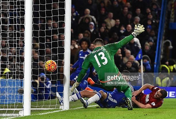 West Bromwich Albion's Northern Irish defender Gareth McAuley bundles the ball into his own net under pressure from Chelsea's Brazilian striker...