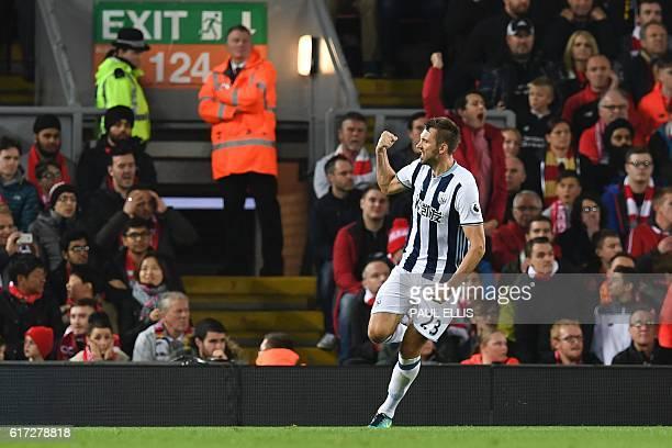 West Bromwich Albion's Northern Irish defender Gareth McAuley celerbates scoring their first goal during the English Premier League football match...