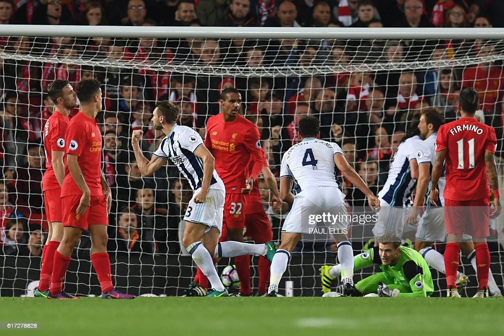 West Bromwich Albion's Northern Irish defender Gareth McAuley (3L) turns to celerbate scoring their first goal during the English Premier League football match between Liverpool and West Bromwich Albion at Anfield in Liverpool, north west England on October 22, 2016. / AFP / PAUL ELLIS / RESTRICTED TO EDITORIAL USE. No use with unauthorized audio, video, data, fixture lists, club/league logos or 'live' services. Online in-match use limited to 75 images, no video emulation. No use in betting, games or single club/league/player publications. /