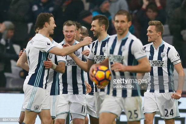 West Bromwich Albion's Northern Irish defender Jonny Evans and West Bromwich Albion's Northern Irish defender Gareth McAuley celebrate their late...