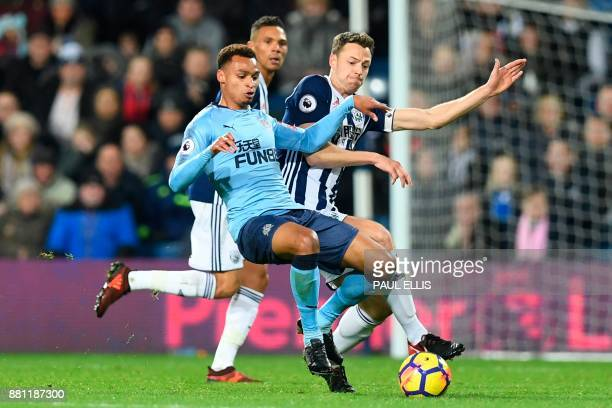 West Bromwich Albion's Northern Irish defender Jonny Evans defends against Newcastle United's English midfielder Jacob Murphy during the English...