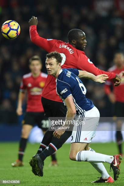 West Bromwich Albion's Northern Irish defender Jonny Evans vies with Manchester United's Belgian striker Romelu Lukaku during the English Premier...