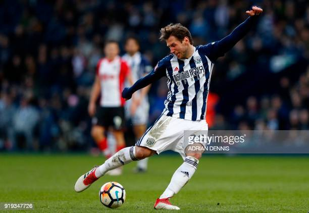 West Bromwich Albion's Polish midfielder Grzegorz Krychowiak has an unsuccessful shot during the English FA Cup fifth round football match between...