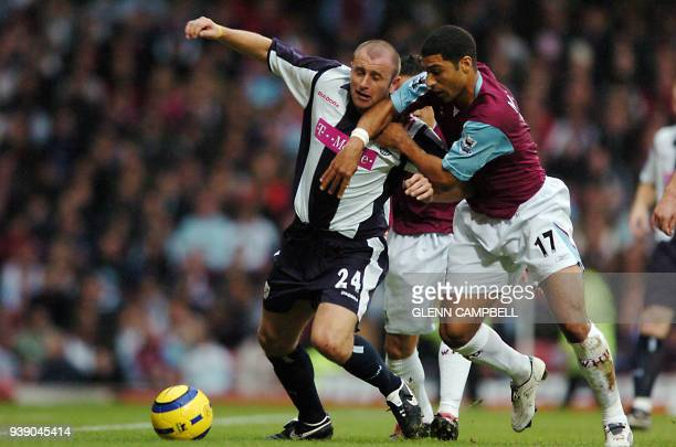 West Bromwich Albion's Ronnie Wallwork and West Ham United player Hayden Mullins attempt to control the ball during the English Premier League match...