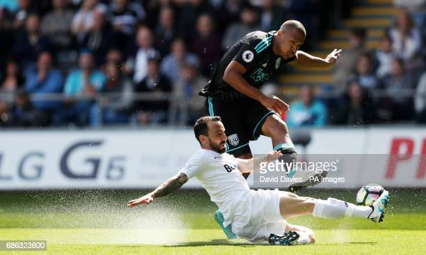 West Bromwich Albion's Salomon Rondon is tackled by Swansea City's Leon Britton during the Premier League match at the Liberty Stadium Swansea