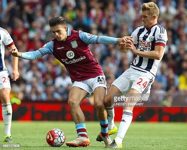 West Bromwich Albion's Scottish midfielder Darren Fletcher vies with Aston Villa's English midfielder Jack Grealish during the English Premier League...