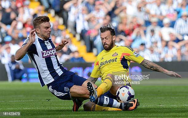 West Bromwich Albion's Scottish midfielder James Morrison vies with Sunderland's Scottish forward Steven Fletcher during the English Premier League...