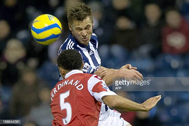 West Bromwich Albion's Swedish forward Markus Rosenberg vies for the ball with Queens Park Rangers' English defender Anton Ferdinand during the...