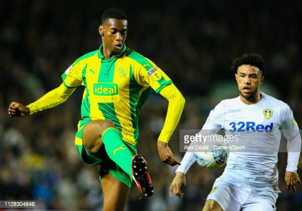 West Bromwich Albion's Tosin Adarabioyo shields the ball from Leeds United's Tyler Roberts during the Sky Bet Championship match between Leeds United...
