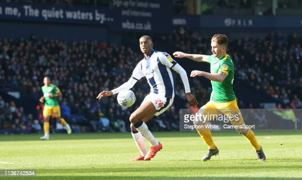 West Bromwich Albion's Tosin Adarabioyo shields the ball from Preston North End's Sean Maguire during the Sky Bet Championship match between West...