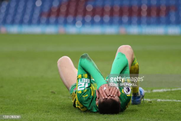 West Bromwich Albion's Turkish midfielder Okay Yokuslu reacts after missing a chance during the English Premier League football match between Burnley...