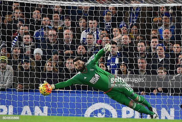 West Bromwich Albion's USborn Welsh goalkeeper Boaz Myhill makes a save during the English Premier League football match between Chelsea and West...