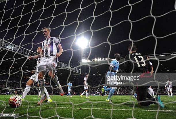 West Bromwich Albion's USborn Welsh goalkeeper Boaz Myhill reacts after Manchester City's Belgian defender Vincent Kompany scored during the English...