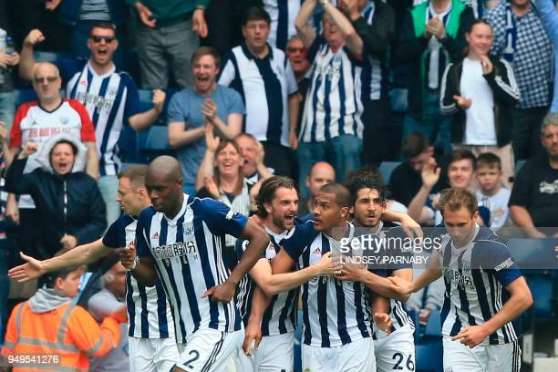 West Bromwich Albion's Venezuelan striker Salomon Rondon celebrates with his teammates after scoring their second goal to equalise 22 during the...