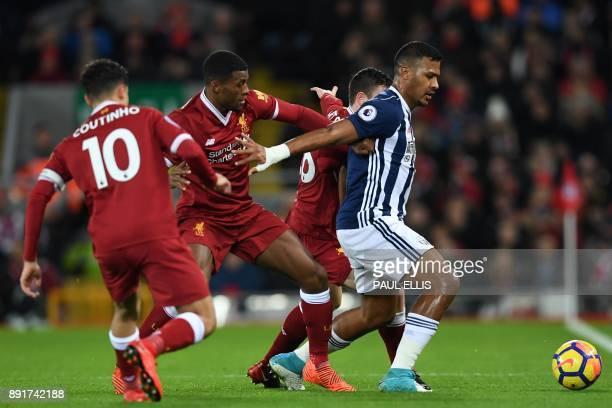 West Bromwich Albion's Venezuelan striker Salomon Rondon shields the ball from Liverpool's Brazilian midfielder Philippe Coutinho Liverpool's Dutch...
