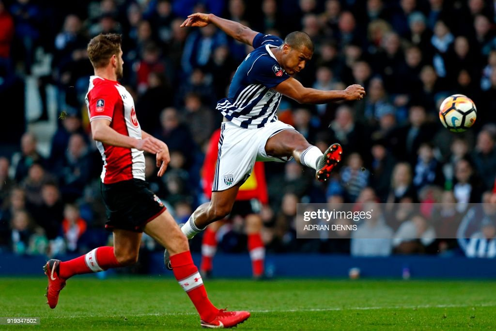 West Bromwich Albion's Venezuelan striker Salomon Rondon shoots to score their first goal during the English FA Cup fifth round football match between West Bromwich Albion and Southampton at The Hawthorns stadium in West Bromwich, central England, on February 17, 2018. PHOTO / Adrian DENNIS / RESTRICTED TO EDITORIAL USE. No use with unauthorized audio, video, data, fixture lists, club/league logos or 'live' services. Online in-match use limited to 75 images, no video emulation. No use in betting, games or single club/league/player publications. /