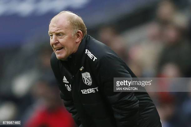 West Bromwich caretaker coach Gary Megson gestures during the English Premier League football match between Tottenham Hotspur and West Bromwich...