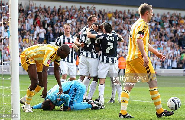 West Bromwich players celebrate the opening goal as Steve Harper of Newcastle kneels injured on the turf during the Coca-Cola Championship match...