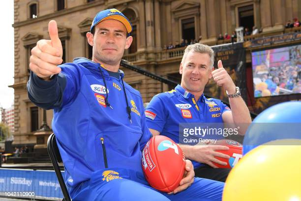 West Coast Eagles captain Shannon Hurn and West Coast Eagles coach Adam Simpson wave to the crowd during the 2018 AFL Grand Final Parade on September...