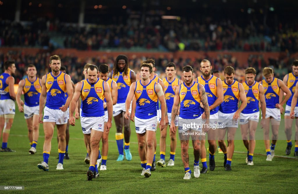 West Coast Eagles players walk from the field looking dejected after the round 15 AFL match between the Adelaide Crows and the West Coast Eagles at Adelaide Oval on June 30, 2018 in Adelaide, Australia.