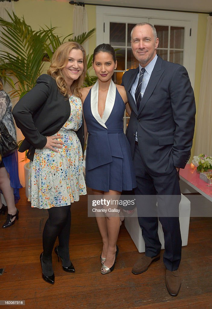 "West Coast Editor of Vanity Fair Krista Smith wearing Juicy Couture, actress Olivia Munn wearing Juicy Couture and Publisher of Vanity Fair Edward Menicheschi attend Vanity Fair and Juicy Couture's Celebration of the 2013 ""Vanities"" Calendar hosted by Vanity Fair West Coast Editor Krista Smith and actress Olivia Munn in support of the Regional Food Bank of Oklahoma, a member of Feeding America, at the Chateau Marmont on February 18, 2013 in Los Angeles, California."
