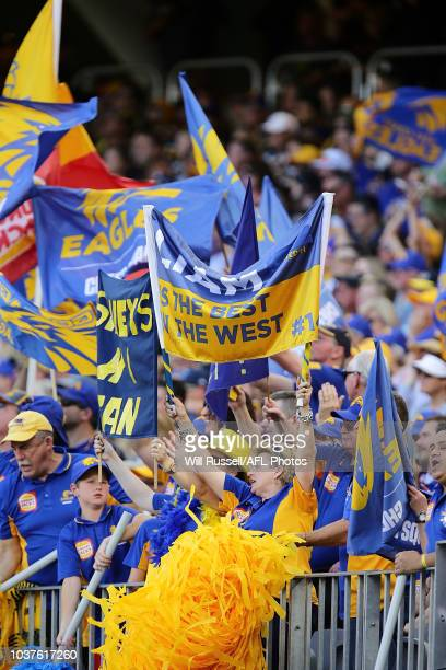 West Coast fans celebrate a goal during the AFL Prelimary Final match between the West Coast Eagles and the Melbourne Demons on September 22 2018 in...