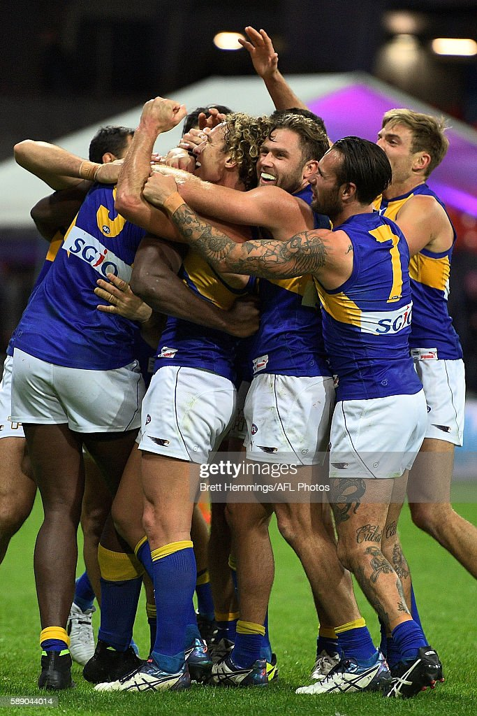 West Coast players celebrate victory during the round 21 AFL match between the Greater Western Sydney Giants and the West Coast Eagles at Spotless Stadium on August 13, 2016 in Sydney, Australia.