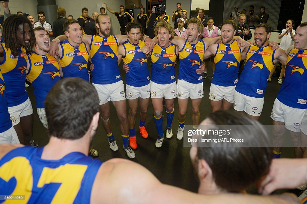 West Coast players sing their team song after victory during the round 21 AFL match between the Greater Western Sydney Giants and the West Coast Eagles at Spotless Stadium on August 13, 2016 in Sydney, Australia.