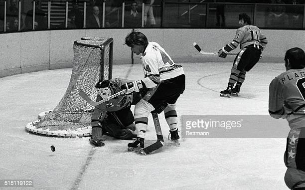 West Division AllStars' goalie Tony Esposito deflects puck off stick of East Division's Bobby Orr during first period of NHL AllStar game here 1/30