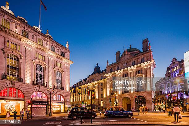 west end, cabs (taxis) in piccadilly circus - piccadilly stock pictures, royalty-free photos & images