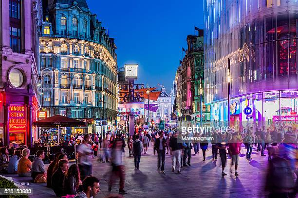 west end, people in leicester square - high street stock pictures, royalty-free photos & images