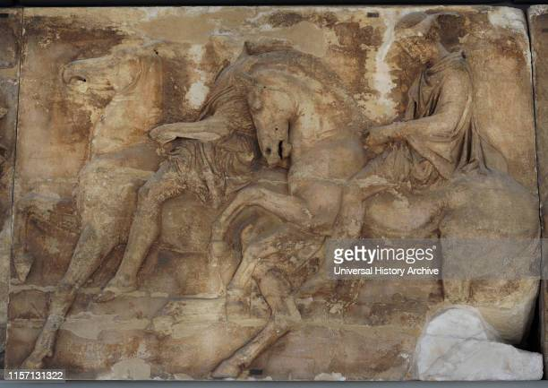 West frieze of Parthenon, Acropolis of Athens, Greece. Block W IX, figures 16-17. A rider is depicted on a trotting horse. Another horseman with...