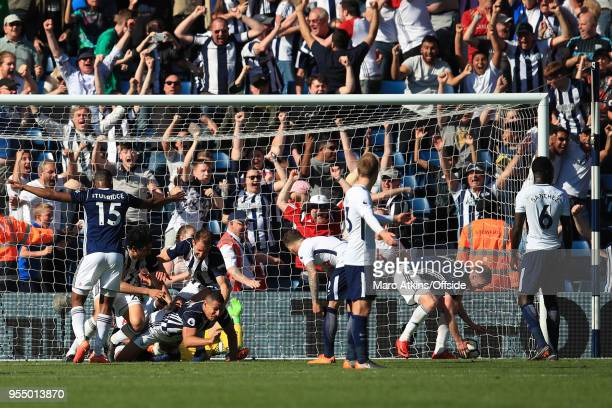 West From players celebrate with Jake Livermore after he scores an injury time goal during the Premier League match between West Bromwich Albion and...