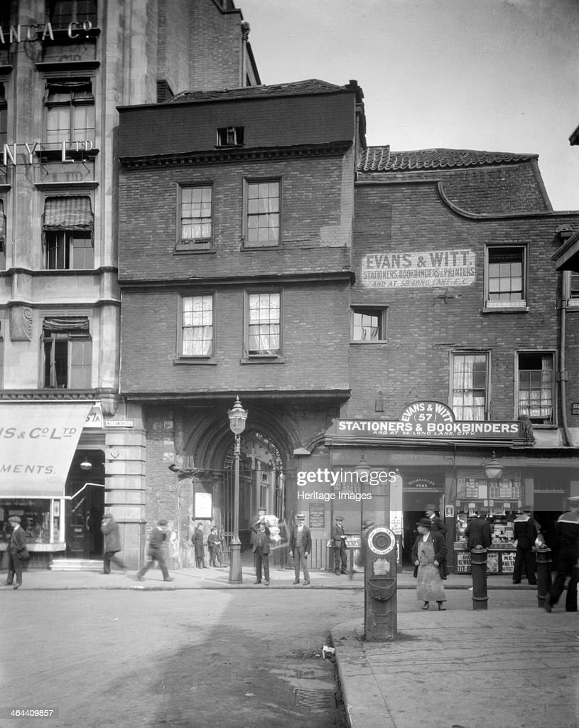 West Gateway leading to the Church of St Bartholomew the Great, West Smithfield, London, 1915. The West Gateway, timbered beneath its brick facade, is visible beyond the lamp post, and leads to the church, which is part of a priory founded in 1123. Smithfield was a place of public excution for over 400 years, and excavations outside the west doorway have uncovered the remains of people who were burned to death.