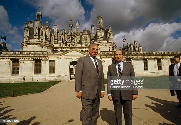 West German chancellor Helmut Kohl and French president Francois Mitterrand stand outside the Chateau de Chambord