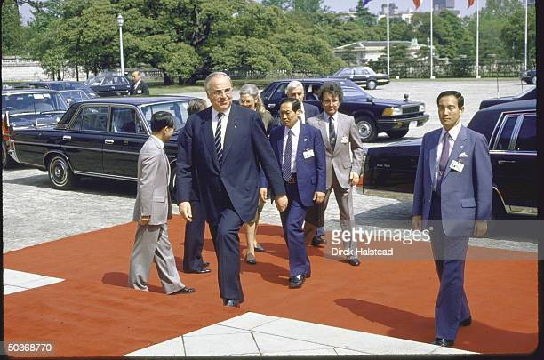 West German Chancellor Helmut Kohl arriving at Akasaka Palace with red carpet treatment for Economic Summit.