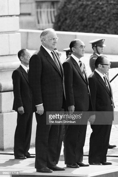 West German Chancellor Helmut Kohl attends the welcome ceremony with Japanese Prime Minister Yasuhiro Nakasone ahead of the Summit meeting at the...