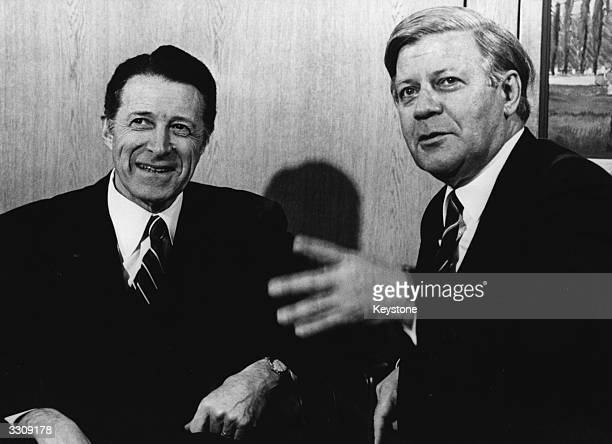 West German Chancellor Helmut Schmidt and US Secretary of Defence Caspar Weinberger converse during the 29th meeting of the Nuclear Planning Group of...