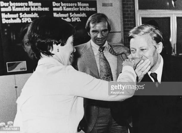 West German Chancellor Helmut Schmidt kisses the hand of his wife Hannelore 'Loki' Schmidt during the final phase of his election campaign 29th...