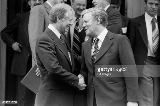 West German Chancellor Helmut Schmidt shakes hands with President Jimmy Carter after paying a visit on him at Winfield House the American...