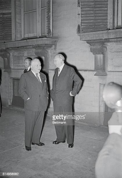 West German Chancellor Konrad Adenauer talks with Luxembourg Premier Joseph Bech outside the Belgian Foreign Office after the third session of the...