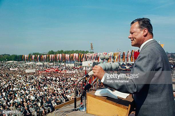West German Chancellor Willi Brandt speaks to a huge crowd of West Berliners in front of the Reichstag on May Day in 1966