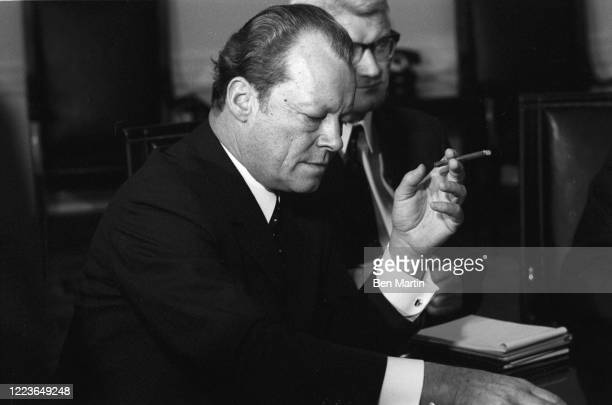 West German chancellor, Willy Brandt, and Polish Prime Minister, Josef Cyrankiewicz at the Presidential Palace to sign the Polish-German treaty which...