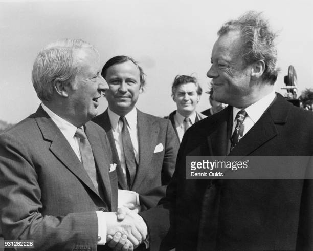 West German Chancellor Willy Brandt is greeted by British Prime Minister Edward Heath upon his arrival at Northolt by air UK 20th April 1972 Brandt...