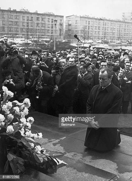 West German Chancellor Willy Brandt kneels in front of the Jewish Heroes monument paying tribute to Jews killed by the Nazis during the 1943 uprising...