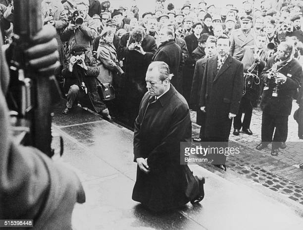 West German Chancellor Willy Brandt paying tribute to the Jewish insurgents killed by the Nazis during uprising in the Jewish ghetto in Warsaw in...
