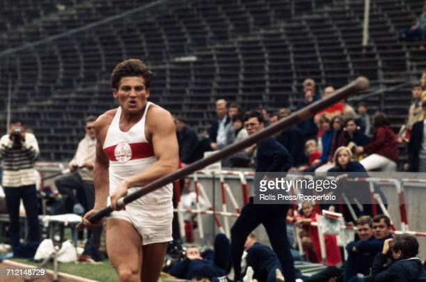 West German decathlete Kurt Bendlin pictured in action competiting in the pole vault discipline of the decathlon competition at an Olympic trials...
