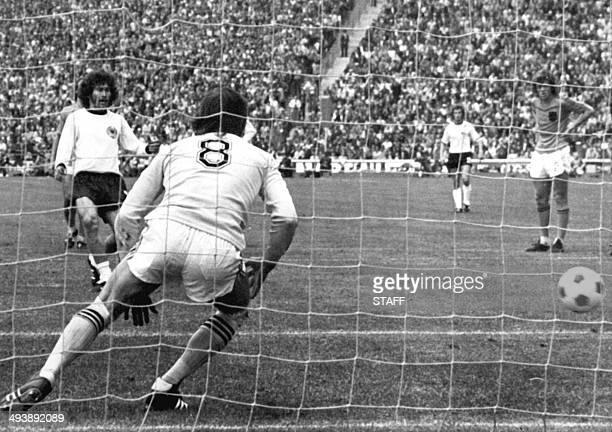 West German defender Paul Breitner ties the score at 1 on a penalty kick as he beats Dutch goalkeeper Jan Jongbloed 07 July 1974 in Munich during the...